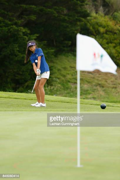 Heaven Kim competes in the Chip competition for 1011 year old girls during the Drive Chip and Putt Western Region Qualifying tournament at The...