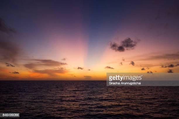 Heavenly scenery of twilight sky over calm sea