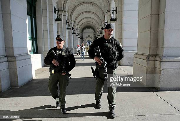 Heavily armed Amtrak police patrol the front entrance of Union Station November 25 2015 in Washington DC With the recent terror attacks in Paris...