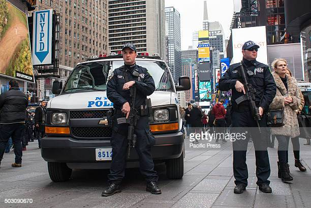 Heavily armed NYPD counterterrorism officers stand at post near the entrance to the restricted zone between 42nd and 43rd Streets With a heightened...