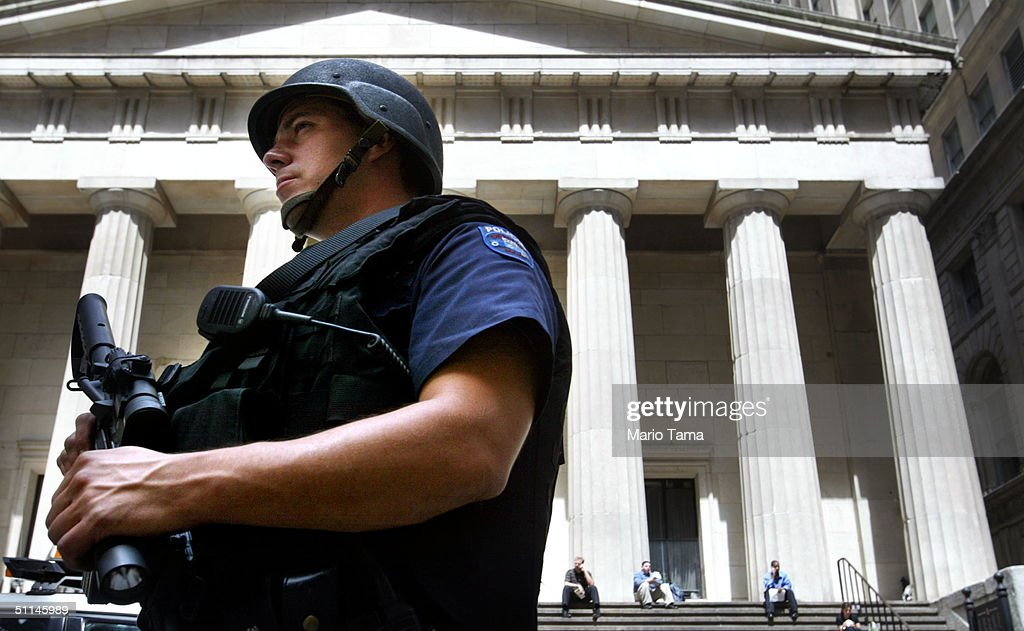 A heavily armed NYPD officer stands guard outside the New York Stock Exchange August 5, 2004 in New York City. The U.S. federal government raised the terror alert to orange in New York City, Newark, New Jersey and Washington, DC areas amidst warnings of potential terrorist attacks against financial institutions.