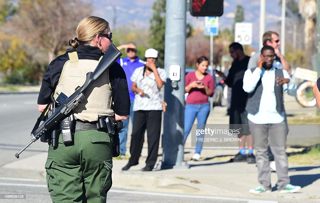 A heavily armed officer sets up a perimeter near the site of a shooting that took place on December 2 2015 in San Bernardino California One or more...