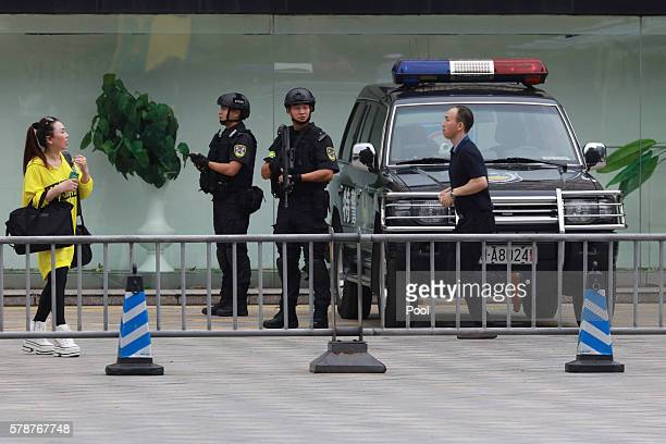 Heavily armed police officers stand guard near the venue where the G20 Finance Ministers and Central Bank Governors Meeting will be held over the...