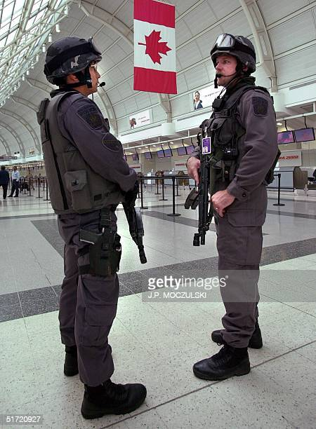 Heavily armed police patrol in Toronto's Pearson International Airport 12 September 2001 in response to terrorist attacks that took place in the...