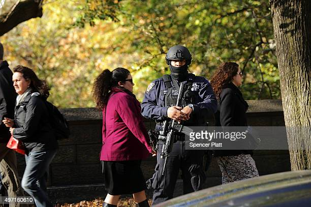 Heavily armed Police stand guard in front of the Consulate General of France in New York the day after an attack on civilians in Paris on November 14...