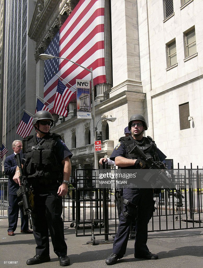 Heavily armed police stand guard outside the New York Stock Exchange 02 August, 2004 in New York. The exchange was one of five financial institutions in New York, Washington and New Jersey that were specifically named in a terror warning issued 01 August by the US Department of Homeland Security. AFP PHOTO/Mandel NGAN