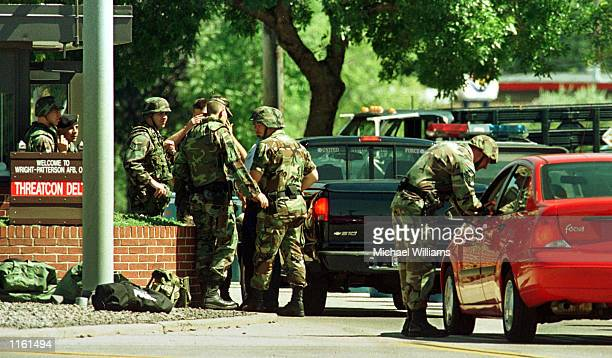 Heavily armed US Air Force security personnel at Wright Patterson Air Force Base search vehicles September 11 2001 as they attempt to enter the huge...