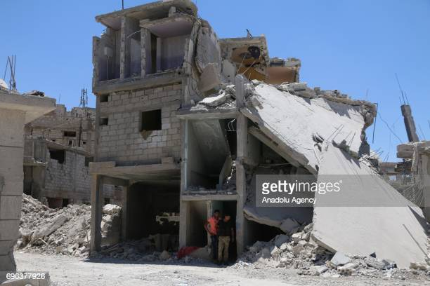 Heavily damaged buildings are seen after Assad regime's barrel bomb airstrike over residential areas in Daraa Syria on June 15 2017 At least 1...