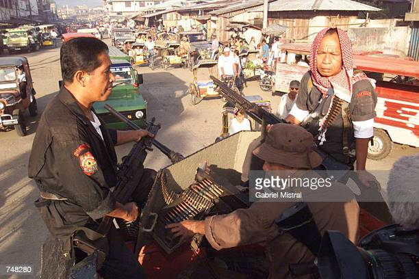 Heavilyarmed Philippine government forces patrol the area along the public market of Jolo in Sulu province in the southern Philippines April 28 2000...
