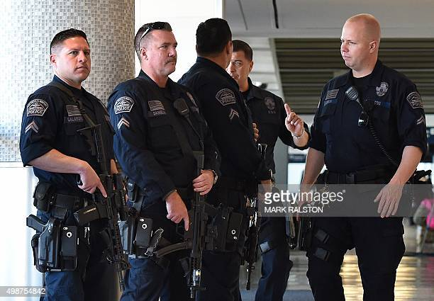 Heavilyarmed police keep watch at Los Angeles International Airport as security is increased for the Thanksgiving holiday and after threats from ISIS...