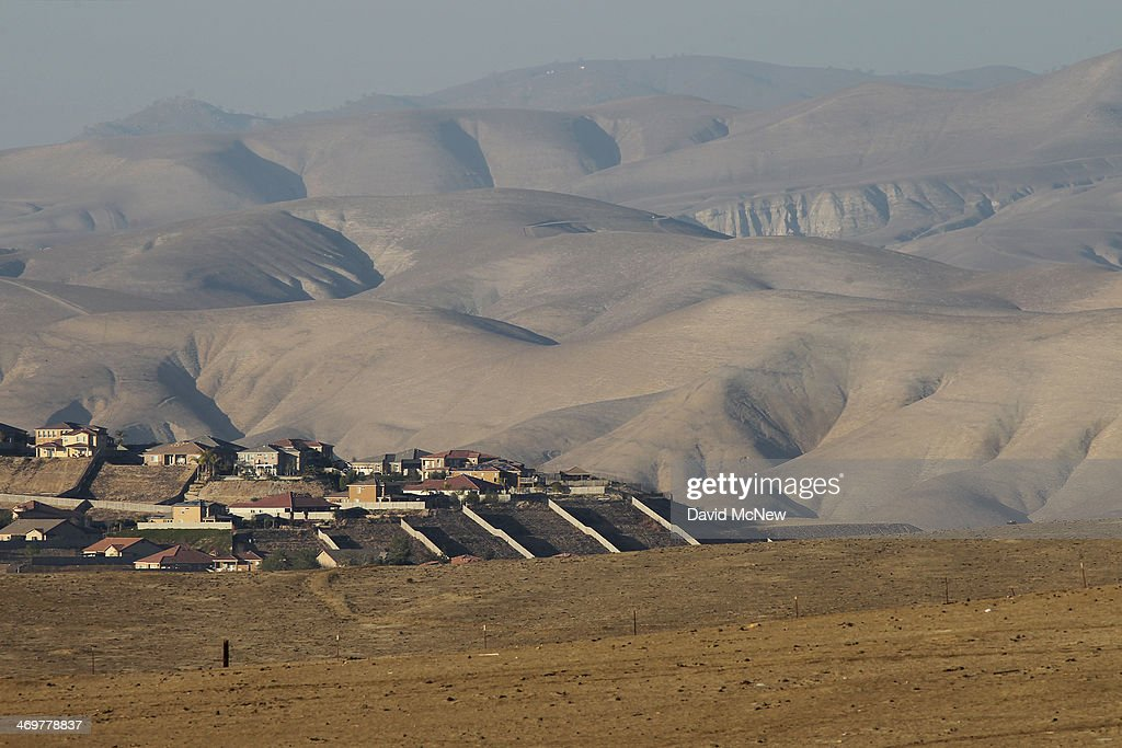 Heavilygrazed pastureland remains barren and dry at the height of the rainy season on February 14 2014 east of Bakersfield California Now in its...