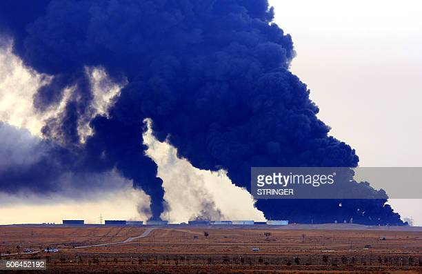 Heavy black smoke rises an oil facility in northern Libya's Ras Lanouf region on January 23 after it caught fire following attacks launched by...