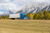 A truck hauling cargo down a Highway. Taken in Canmore, Alberta