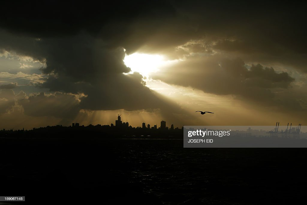 Heavy clouds cover the skies over the Lebanese capital, Beirut on January 7, 2013. Stormy weather, including high winds and heavy rainfall, lashed the eastern Mediterranean coast, downing power lines and trees and causing several injuries in a number of countries.