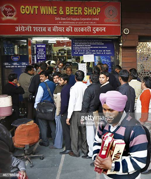 Heavy crowd outside a Wine and Liquor shop at Khan Market ahead on Delhi Assembly elections on February 5 2015 in New Delhi India The sale of Liquor...