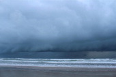 heavy dark clouds above the Atlantic Ocean as Tropical Storm / Hurricane Arthur passes off the coast of Daytona Beach Shores Florida on July 2 2014