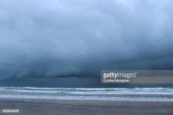 heavy dark clouds above the Atlantic Ocean as Tropical Storm / Hurricane Arthur passes off the coast of Daytona Beach Shores Florida on July 2 2014