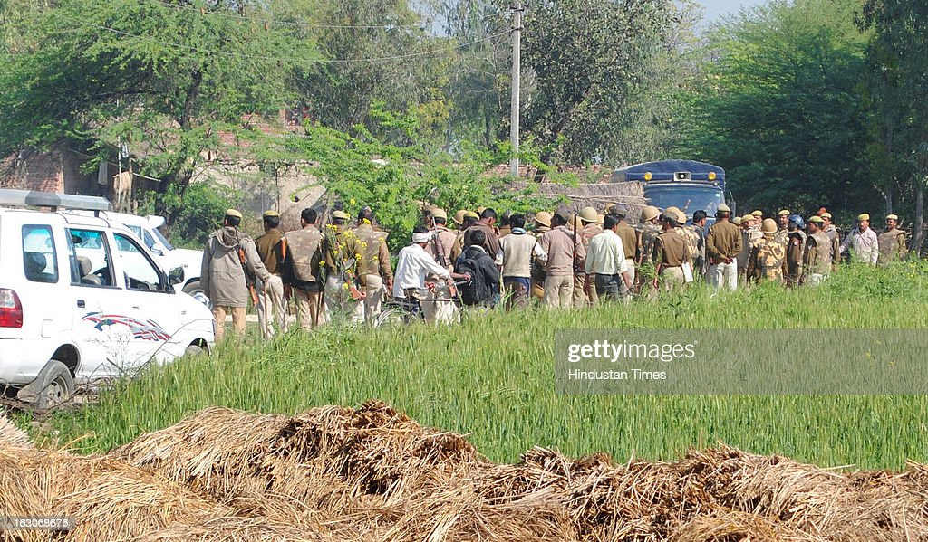 Heavy deployment of Police personnel outside house of slain Balipur gram Pradhan Nanhey Yadav grieving on March 3, 2013 in the Kunda area of Pratapgarh, India. A close confidant of Kunda MLA and state minister Raghuraj Pratap Singh alias Raja Bhaiyya, Nanhe Yadav was murdered by two unidentified gunmen in Village market. The case took another turn after the circle officer of Kunda Zia-ul-Haq who rushed to the site along with other police officials was killed in gunshot from unidentified man in crowd.