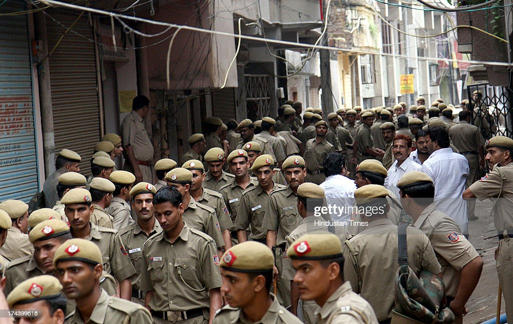 Heavy depolyment of Delhi Police at Batla House a day after the encounter of two suspected militants in Jamia Nagar on September 20, 2008 in New Delhi, India. A Delhi court on July 25, 2013 ruled that 2008 Batla House encounter was genuine and convicted lone suspected Indian Mujahideen operative Shahzad Ahmed of killing Delhi police inspector MC Sharma. Shahzad is said to be one of the occupants of the flat in Jamia Nagar where the encounter took place on September 19, 2008 between the officers of the special cell and the suspected IM terrorists allegedly involved in the September 13, 2008 serial blasts at Karol Bagh, Connaught Place, Greater Kailash and India Gate left 26 dead and 133 injured.