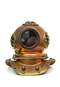 Old brass heavy diving mask isolated over white