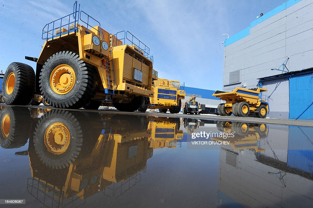 Heavy duty BelAZ dump-trucks stand at the yard of the BelAZ automobile plant in the Belarus town of Zhodino, some 50km north of the capital Minsk, on March 29, 2013.