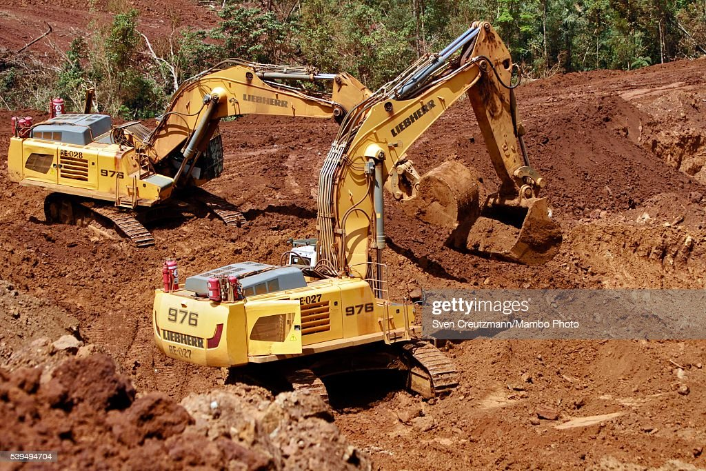 Heavy duty equipment work at the Moa open-pit Nickel mine ...