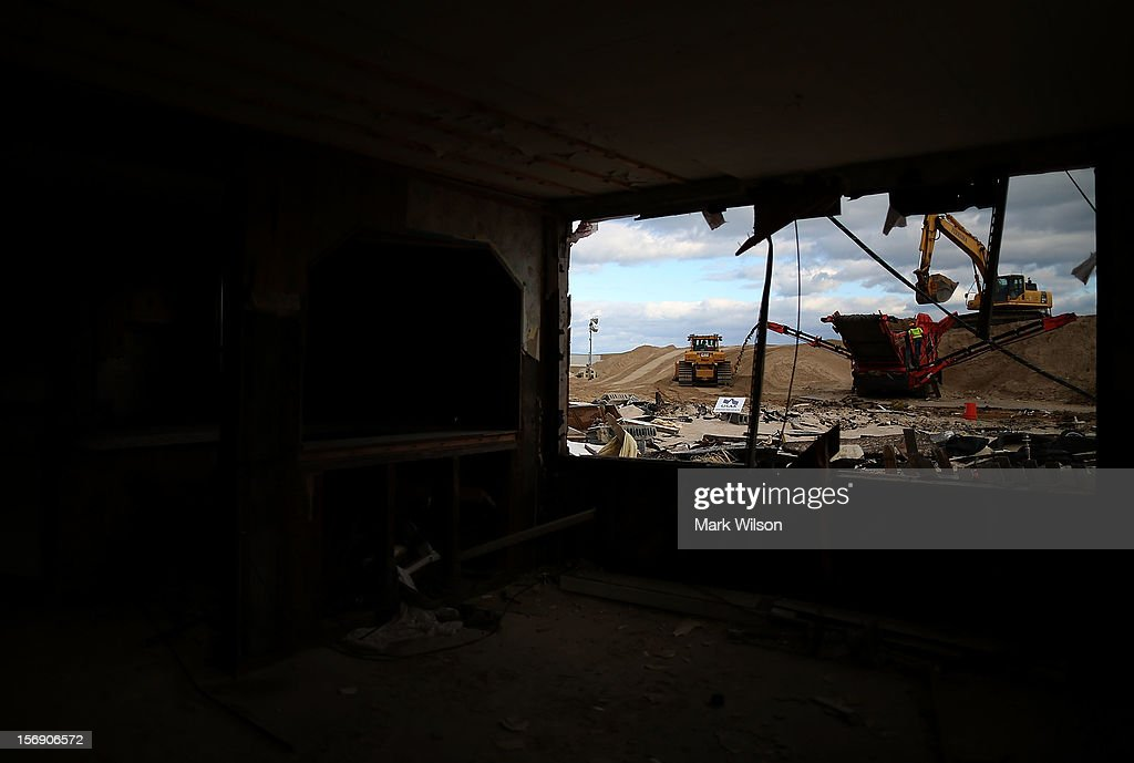 Heavy equipment cleans sand and pushes it onto the beach, on November 24, 2012 in Ortley Beach, New Jersey. New Jersey Gov. Christie estimated that Superstorm Sandy cost New Jersey $29.4 billion in damage and economic losses.