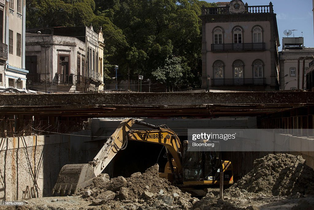 Heavy equipment is used to removes debris from a tunnel at a construction site in Rio de Janeiro, Brazil, on Thursday, Feb. 21, 2013. The tunnel is part of the $4 billion Porto Maravilha infrastructure project which aims to revitalize the the city's downtown and port area ahead of Brazil's hosting of the World Cup and Olympic Games. Photographer: Dado Galdieri/Bloomberg via Getty Images