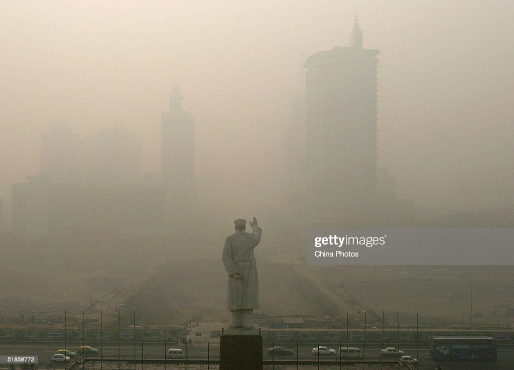 Heavy fog envelopes the Tianfu Plaza where the statue of Mao Zedong stands December 14, 2004 in Chengdu, Sichuan Province of China. The heaviest fog since winter has in some areas reduced visibility is to less than 10 meters (11 yards).