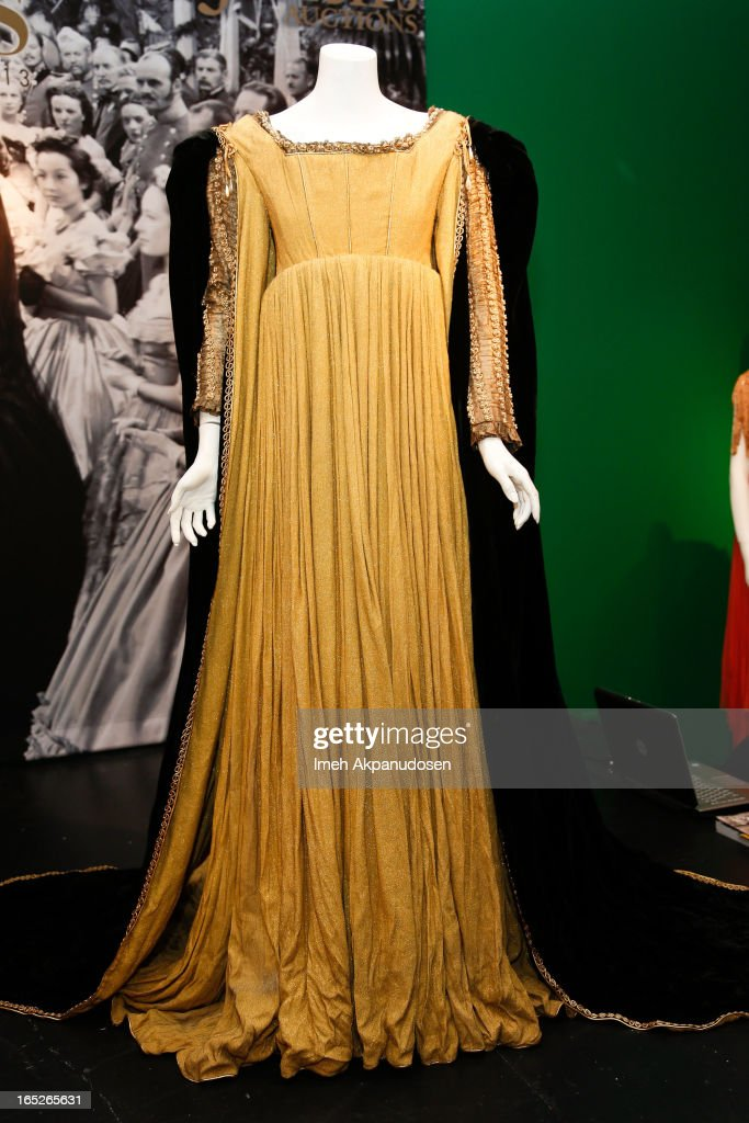 A heavy golden period gown worn by Paulette Goddard as Lucretia Borgia in 'Bride Of Vengeance' on display during the 'Hollywood Legends' auction preview at Julien's Auctions Gallery on April 1, 2013 in Beverly Hills, California.