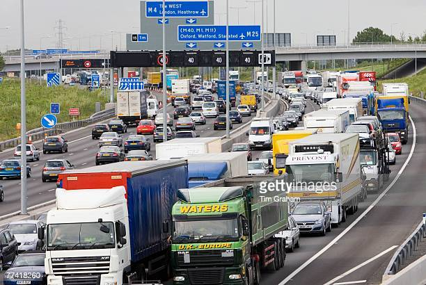 Heavy goods vehicles trucks in traffic congestion on M25 motorway London United Kingdom