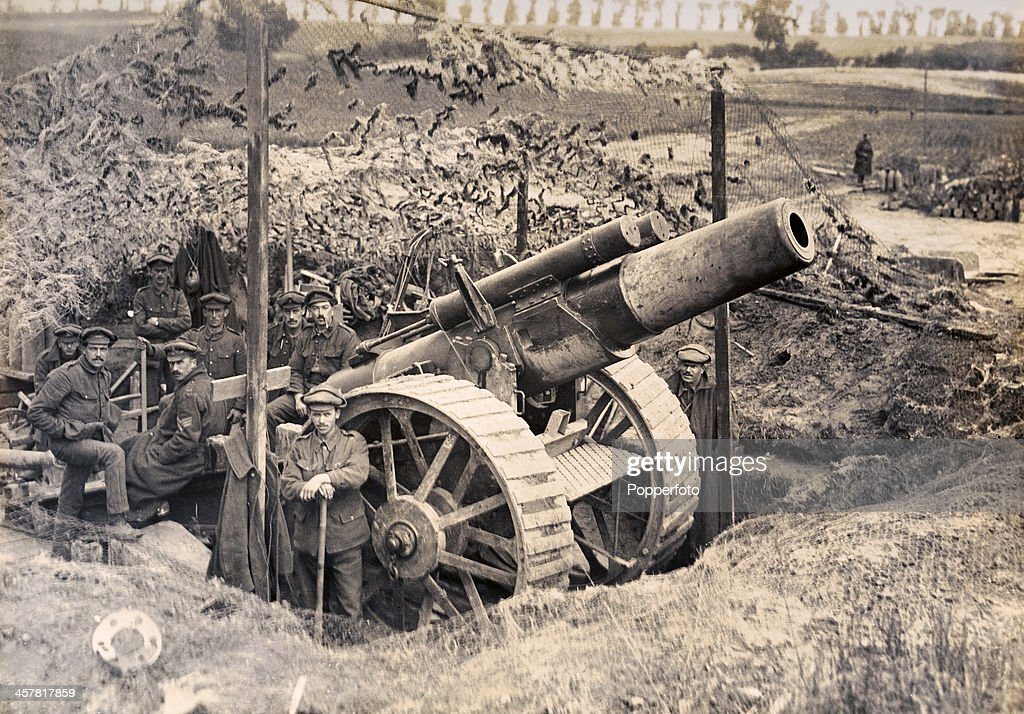 A heavy Howitzer with its gun crew in position on the British Western Front during World War One circa 1917