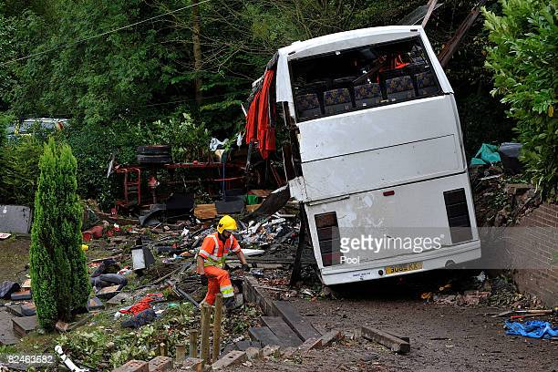 Heavy lifting cranes begin to remove the coach that crashed yesterday evening into a garden the village of Alton August 19 2008 in Alton...