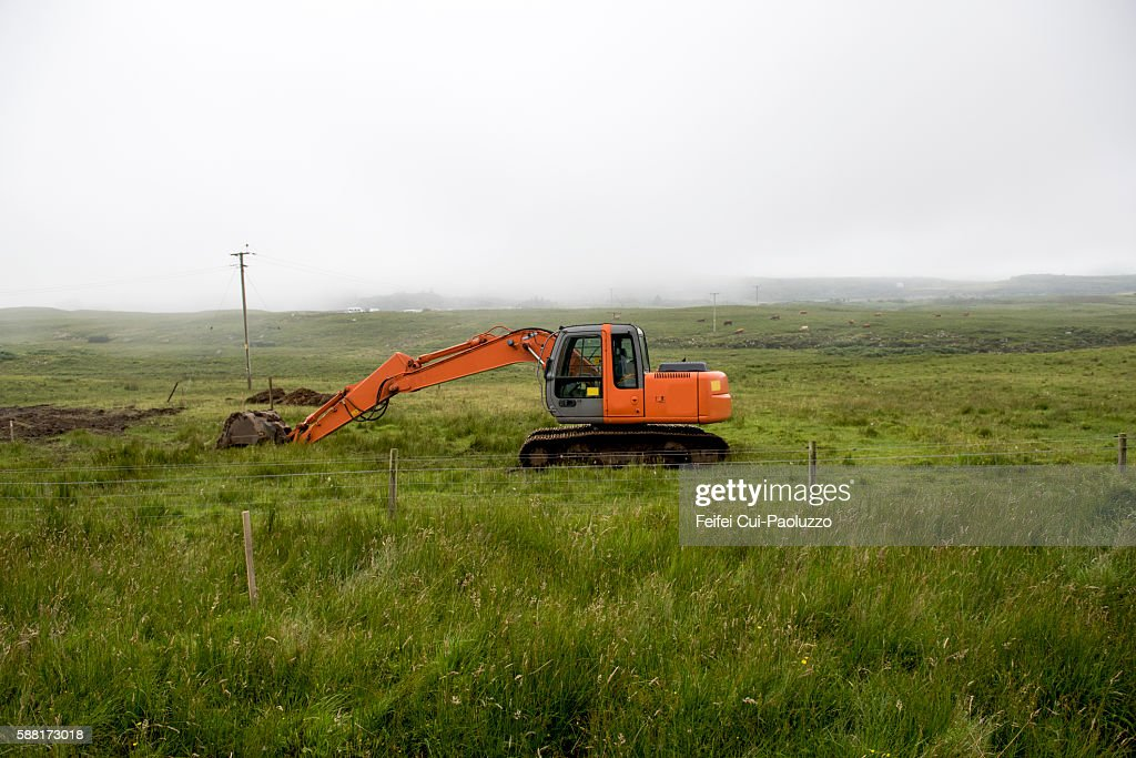 Heavy machine in a field at Ulva of Isle of Mull in Scotland