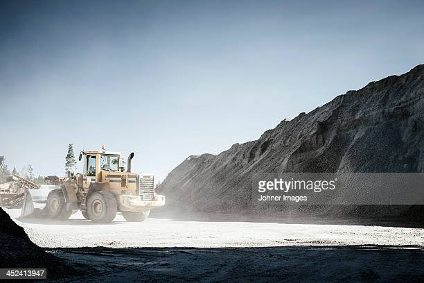 Heavy machine in gravel pit