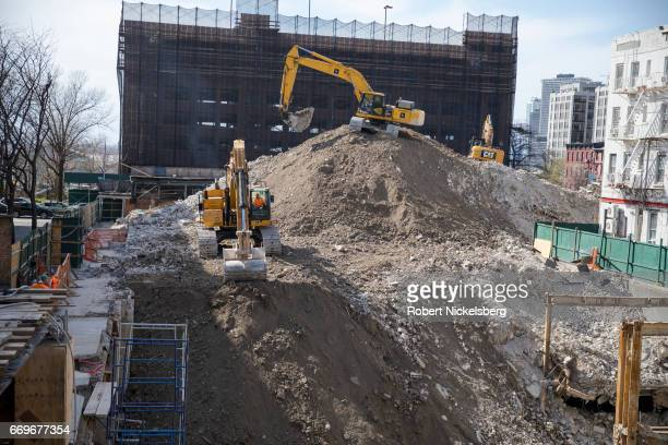 Heavy machinery excavates the foundation of the former Long Island College Hospital April 13 2017 in the Brooklyn borough of New York The hospital...