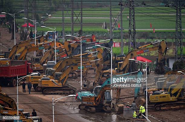 Heavy machinery is parked near the site of search operations for survivors after a landslide hit an industrial park in Shenzhen south China's...