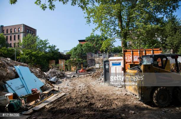 Heavy machinery lies idle on the site where a 15story residential building will be located June 14 2017 in Brooklyn New York The building site is...
