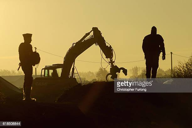 Heavy machinery moves into the Calais 'Jungle' migrant camp to demolish the site on October 27 2016 in Calais France Authorities have now declared th...