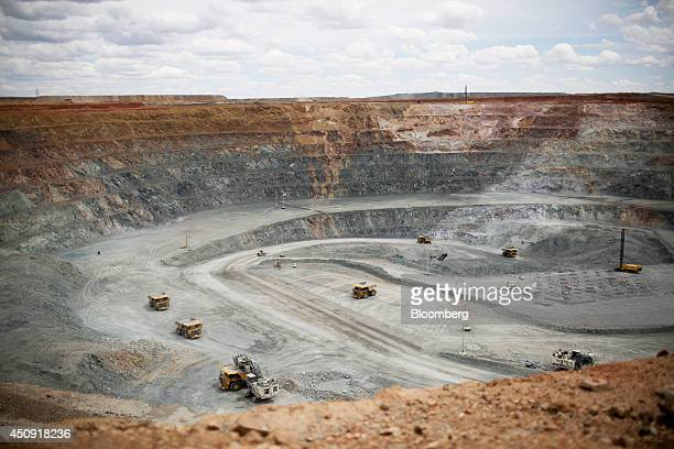 Heavy machinery operate inside an open pit at the Oyu Tolgoi coppergold mine jointly owned by Rio Tinto Group's Turquoise Hill Resources Ltd unit and...