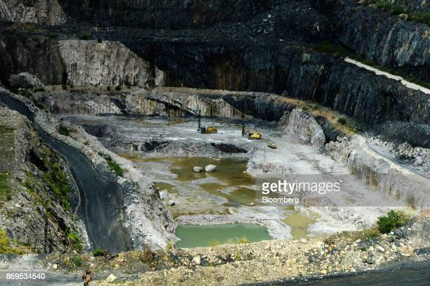Heavy machinery operates in an open pit mine at a Talison Lithium Ltd site a joint venture between Tianqi Lithium Corp and Albemarle Corp in...