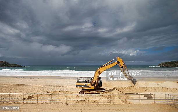 Heavy machinery relocates sand as storm clouds start to disipate at Bondi beach April 23 2015 in Sydney Australia Parts of New South Wales this week...