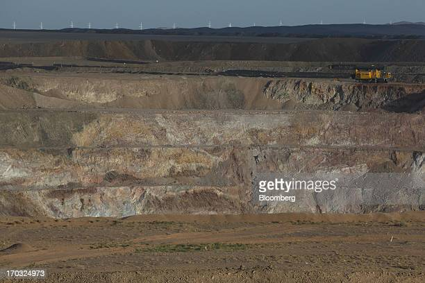 Heavy machinery stands at the open pit of the Oyu Tolgoi coppergold mine jointly owned by Rio Tinto Group's unit Turquoise Hill Resources Ltd and...