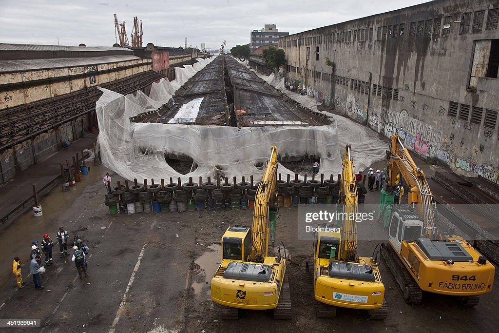 Heavy machinery stands by after the demolition of a 5 km-long stretch of highway to make way for the revitalization of the port area in Rio de Janeiro, Brazil, on Saturday, Nov. 23, 2013. The government will auction three highways before year-end, Finance Minister Guido Mantega told reporters Nov. 22 in Brasilia. Photographer: Dado Galdieri/Bloomberg via Getty Images