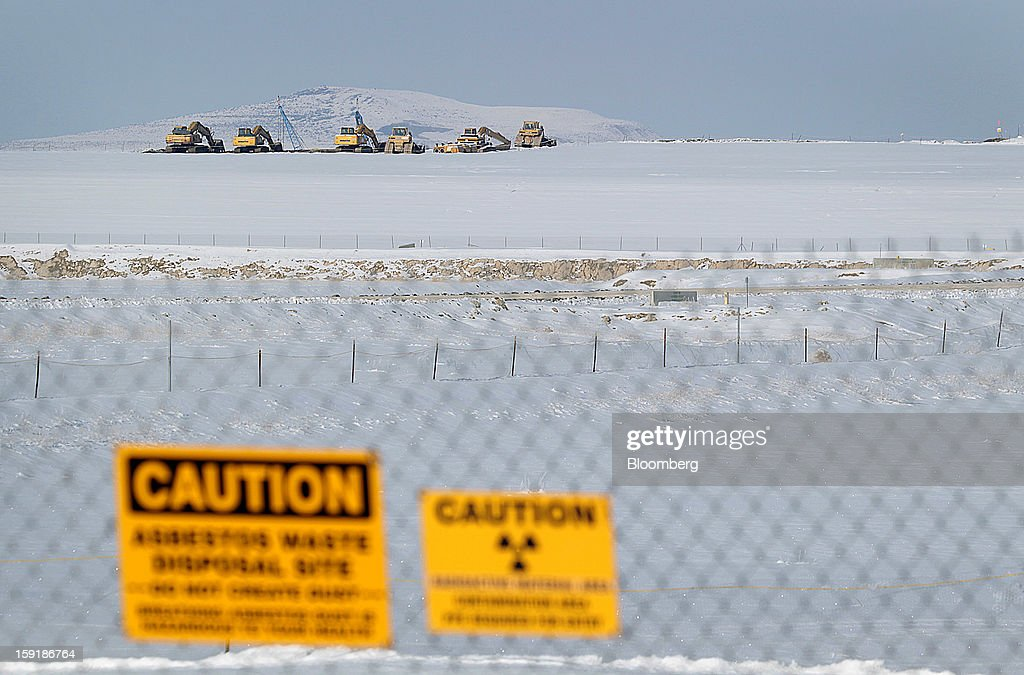 Heavy machinery used to bury and cap low level radioactive waste sits on a ridge at the EnergySolutions Inc. low level radioactive waste disposal site in Clive, Utah, U.S., on Wednesday, Jan. 9, 2013. EnergySolutions Inc. obtained a commitment from Morgan Stanley to provide a senior secured credit facility to back its $1.1 billion buyout by Energy Capital Partners LLC. Photographer: George Frey/Bloomberg via Getty Images
