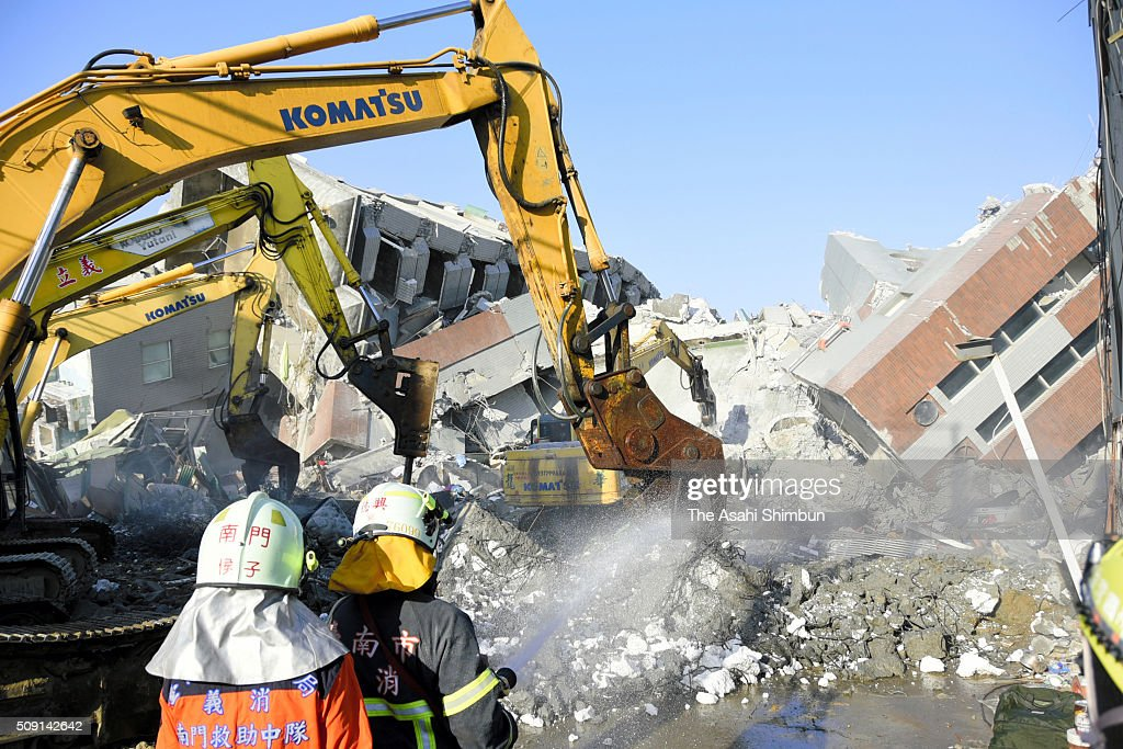 Heavy machines are brought in to demolish the toppled building in hope of finding survivors four days after the magnitude 6.4 earthquake on February 9, 2016 in Tainan, Taiwan. 40 people including 38 from the 17-story building are confirmed dead, and still more than 100 people are thought to have been trapped in the rubble.