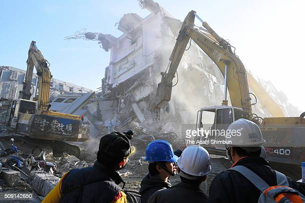 Heavy machines are brought in to demolish the toppled building in hope of finding survivors four days after the magnitude 64 earthquake on February 9...