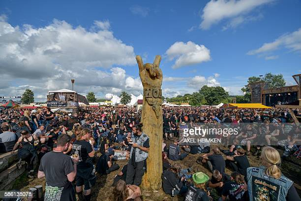 Heavy metal fans wait for the next band to perform at the Wacken Open Air heavy metal festival in Wacken northern Germany on August 5 2016 / AFP /...