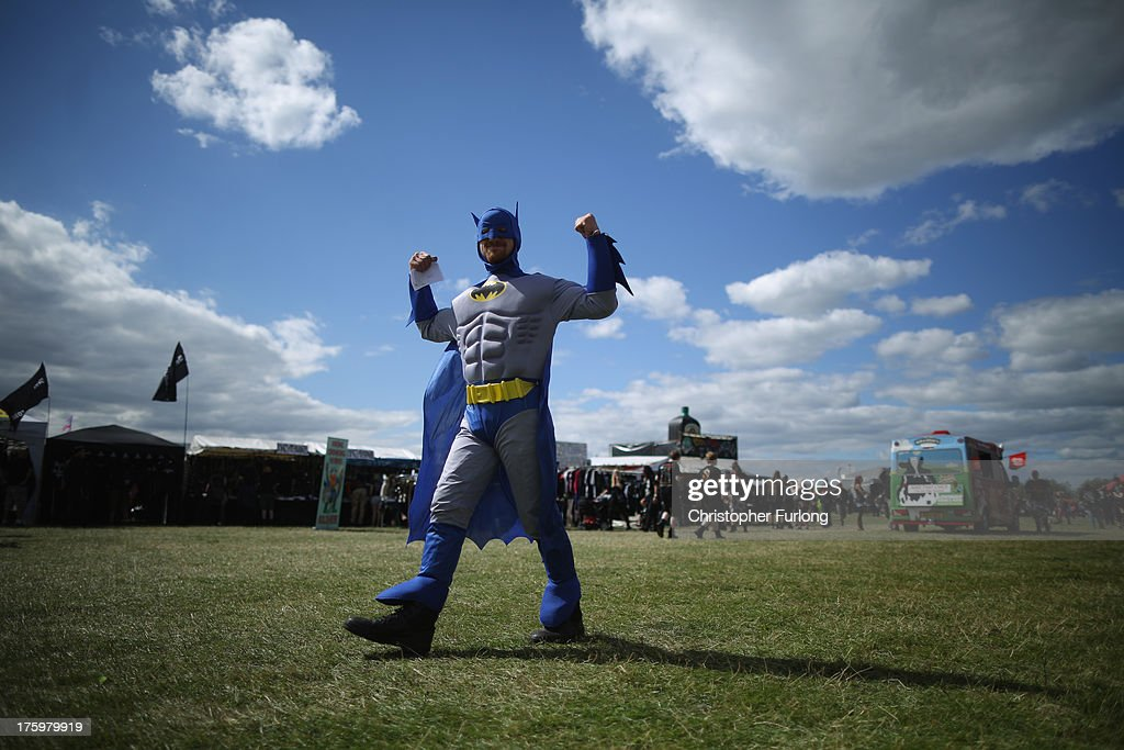 A heavy metal fat dressed as Batman plays to the camera during the Bloodstock Outdoor Heavy Metal Festival on August 10 2013 in Walton Upon Trent...