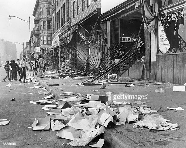 Heavy metal gratings which failed to protect shop windows during the race riots in Detroit The rioters later burned the shops they had looted